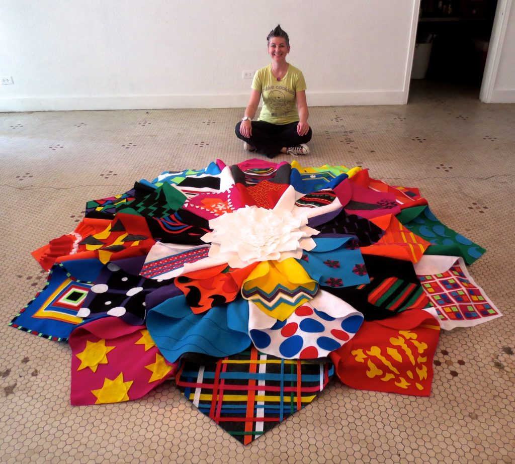 Steph with 7 foot felt flower installation at BeefHaus Gallery for Trans.lation